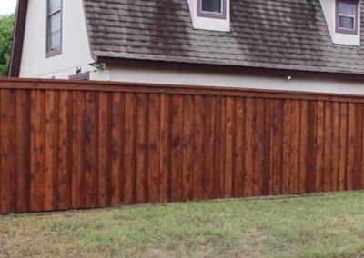 wooden fence around barn